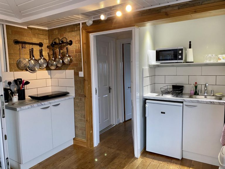 Equipped Kitchenette-diner with door to bedroom and bathroom